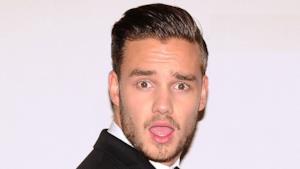 Liam Payne degli One Direction con espressione shock
