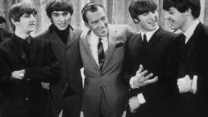 I Beatles con il presentatore Ed Sullivan