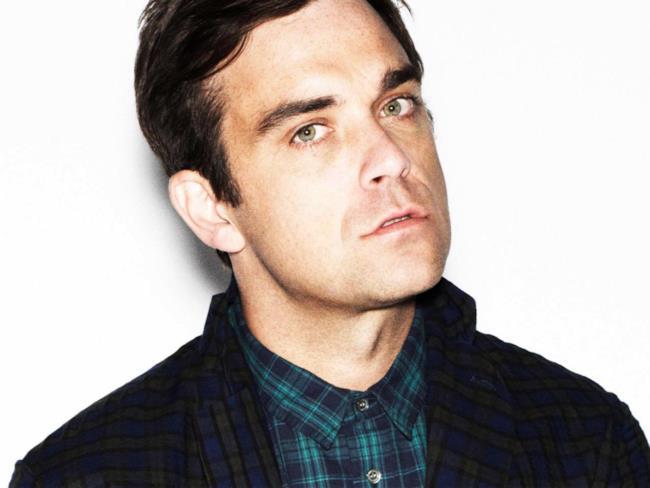 Foto in primo piano di Robbie Williams