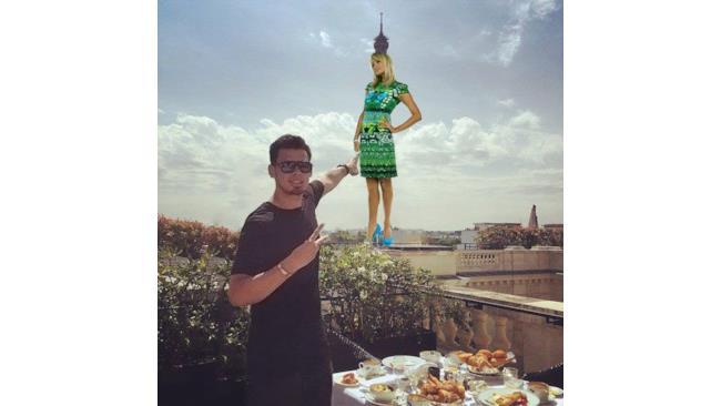 Afrojack vittima di Photoshop: indica una ragazza grande quanto la Tour Eiffel