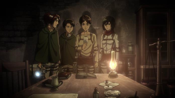 Eren e gli altri osservano la foto lasciata da Grisha