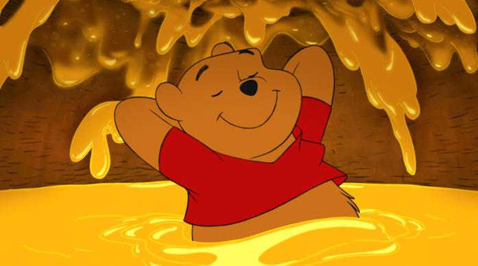 Winnie the Pooh immerso nel miele