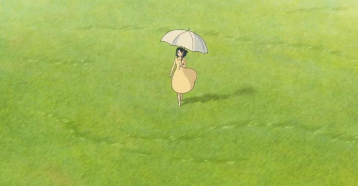 Nahoko cammina con un ombrello per ripararsi dal sole in una distesa erbosa nel sogno di Jiro