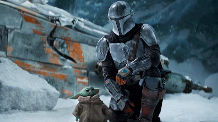 Il Mandalorinao e Baby Yoda in una scena della serie