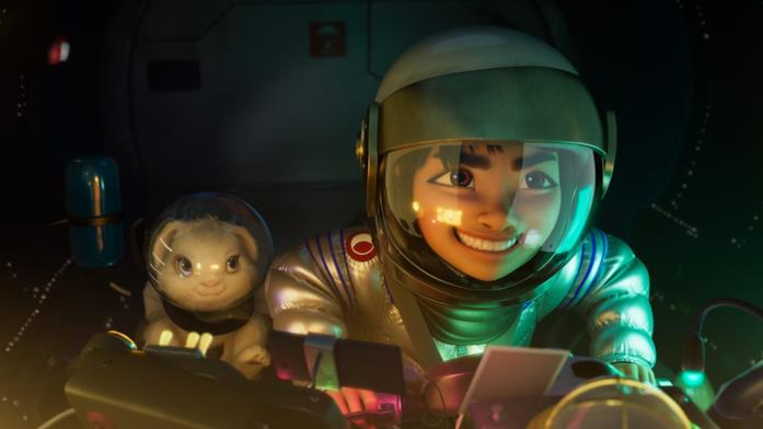 Un ragazzino sta guidando il razzo appena costruito per raggiungere la Luna