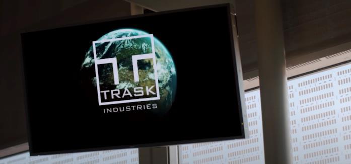 Un monitor che mostra il logo di Trask Industries