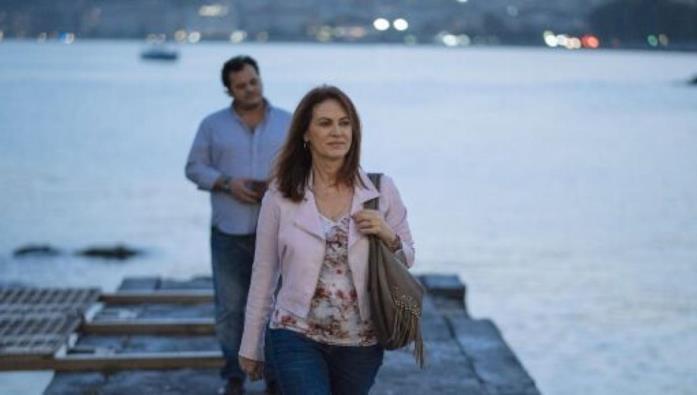 Laura e Renato in Vivi e lascia vivere