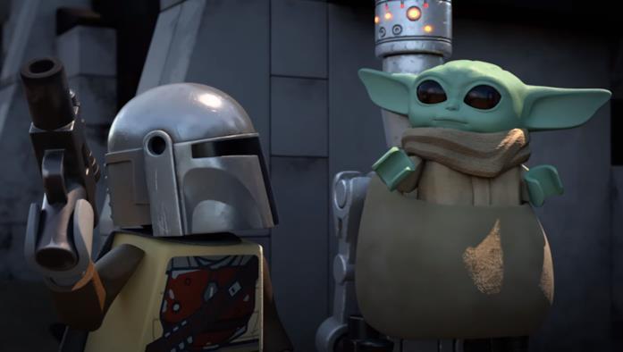 Mando (sinistra) e Baby Yoda (destra) in una scena di LEGO Star Wars Christmas Special