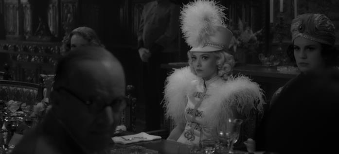 Marion Davies assiste allo scontro tra l'amico e l'amante