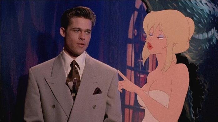 Holli Woyld parla con Brad Pitt nel Mondo Furbo in una scena di Fuga dal mondo dei sogni