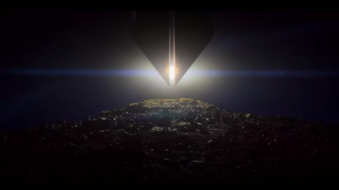 Una persona nel buio guarda il sole coperto da una astronave