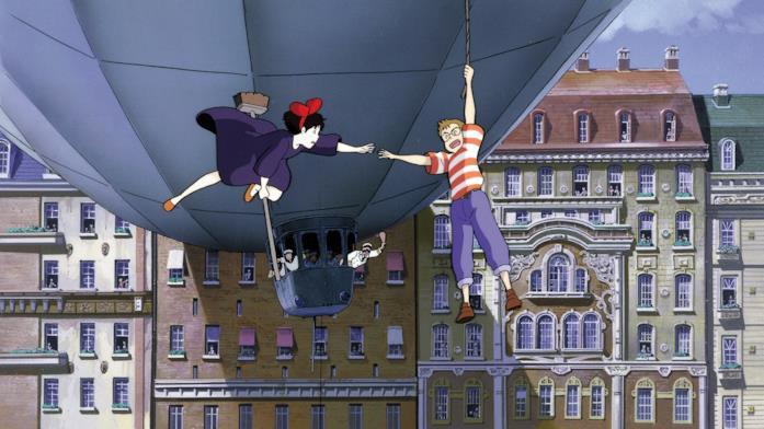 Kiki a bordo di uno scopettone tenta di portare Tombo in salvo