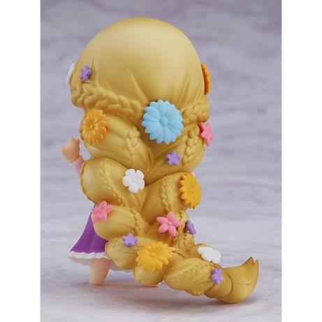 I capelli di Rapunzel ornati di fiori
