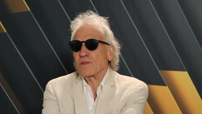 Abel Ferrara con gli occhiali da sole
