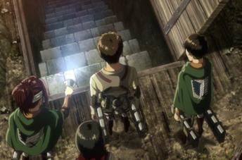 Eren e gli altri guardano le scale che portano alla cantina