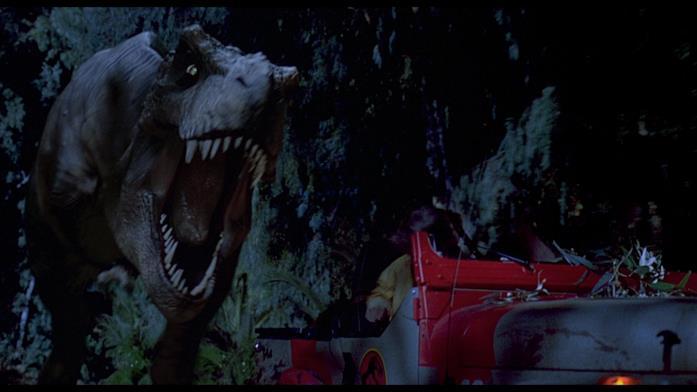 Il T-Rex rincorre la jeep in una delle scene più celebri di Jurassic Park
