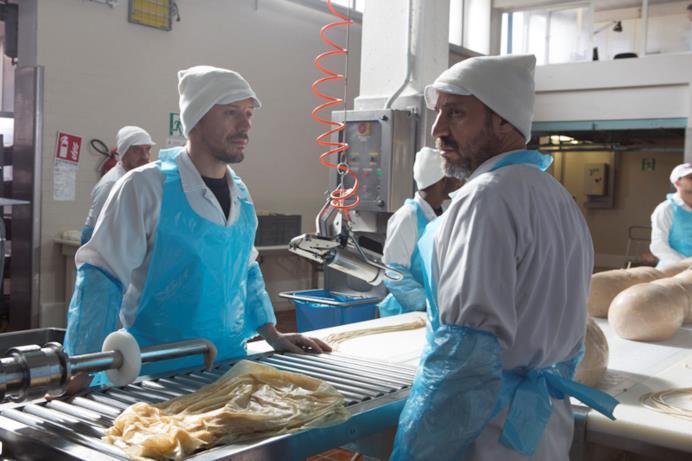 Una scena di Made in Italy con Rico nella salumeria