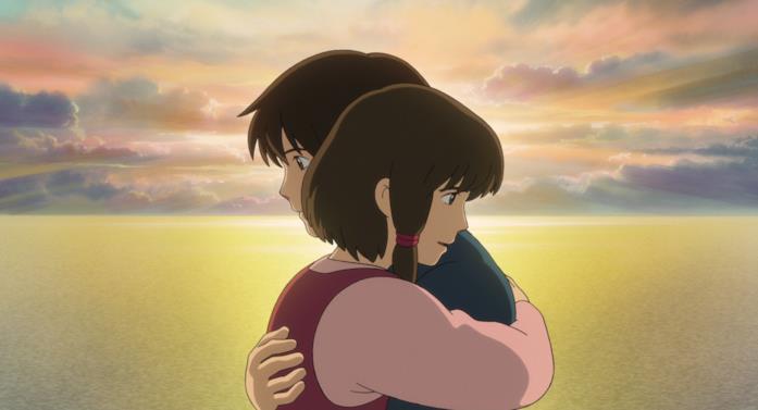 Arren e Therru abbracciati davanti a un tramonto