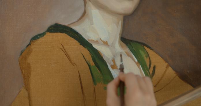 La pittrice dipinge il ritratto