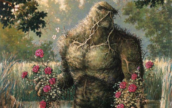 Mezzobusto disegnato di Swamp Thing, in mezzo alla palude e con fiori tra le mani