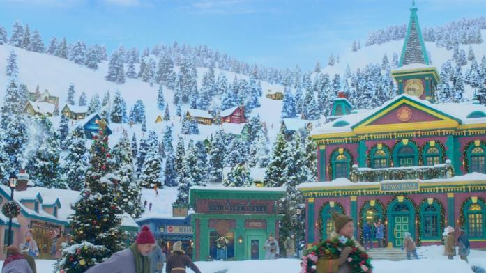 Boschi innevati e casette nel Polo Nord rappresentato in Noelle