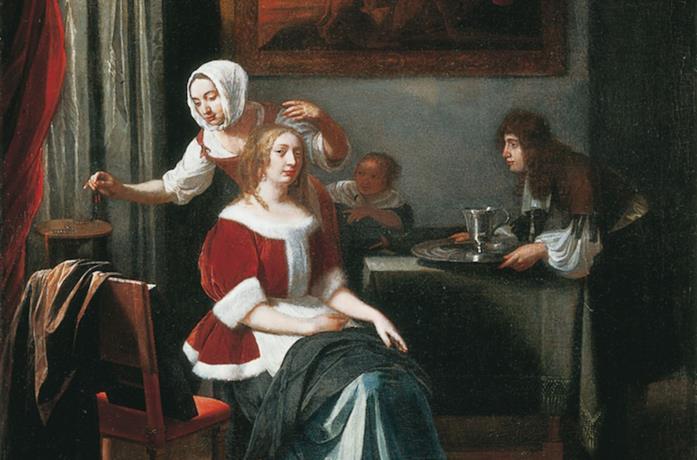 Una donna seduta con due serve