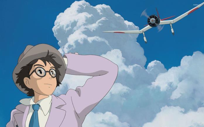 Jiro guarda un aeroplano che vola su un cielo azzurro
