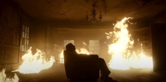 Bradley Cooper seduto in poltrona mentre tutto brucia