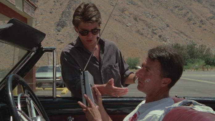 Una scena da Rain Man con Tom Cruise