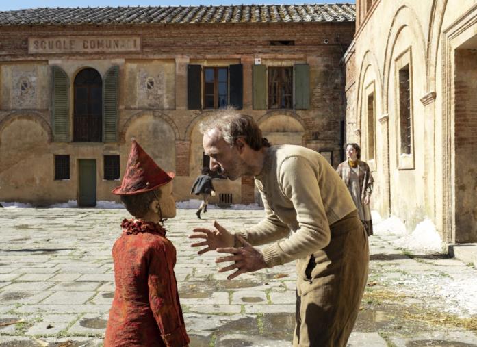 Geppetto porta Pinocchio a scuola