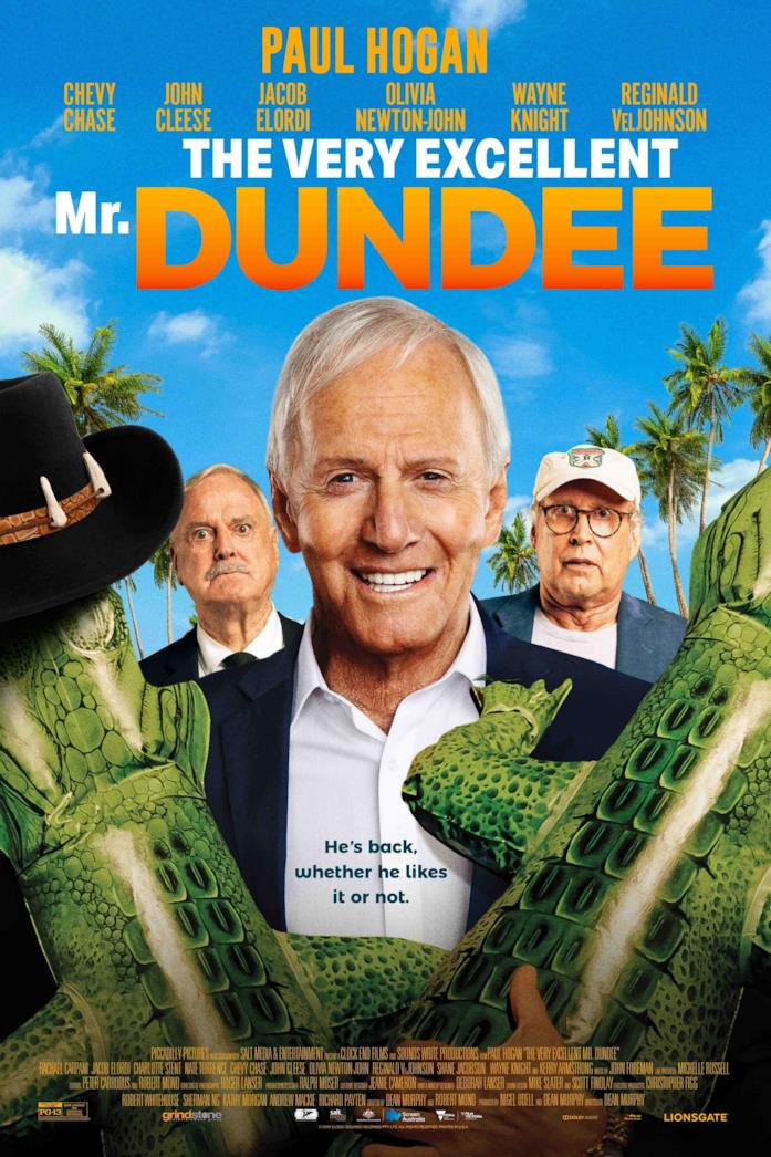 Mr. Dundee con due coccodrilli gonfabili
