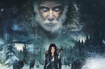 Clair Hamilton, circondata da lupi, cammina tra la neve