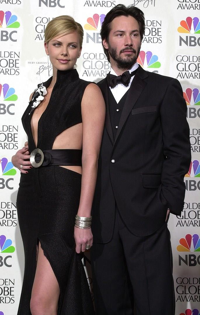 Charlize Theron con Keanu Reeves