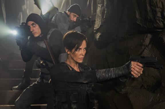 Luca Marinelli e Charlize Theron in due immagini da film precedenti