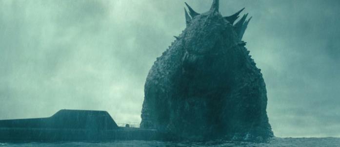 Godzilla emerge dal mare al fianco di un sottomarino