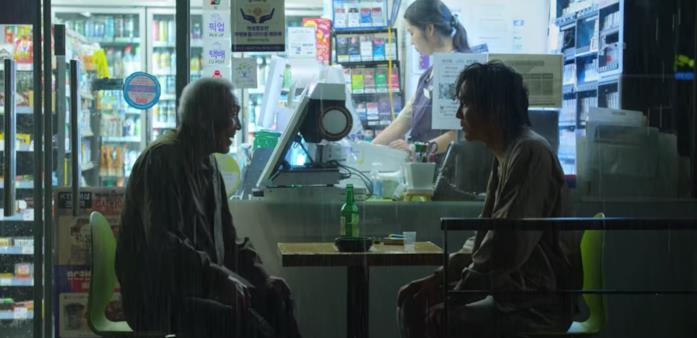 Il-nam e Gi-hun in un bar insieme