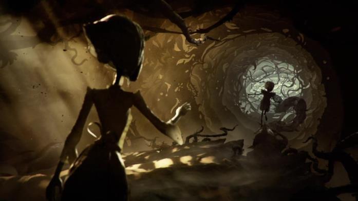 Una donna e una bambina in un tortuoso labirinto di rami