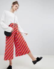 Pantaloni rossi a righe oblique con fondo ampio