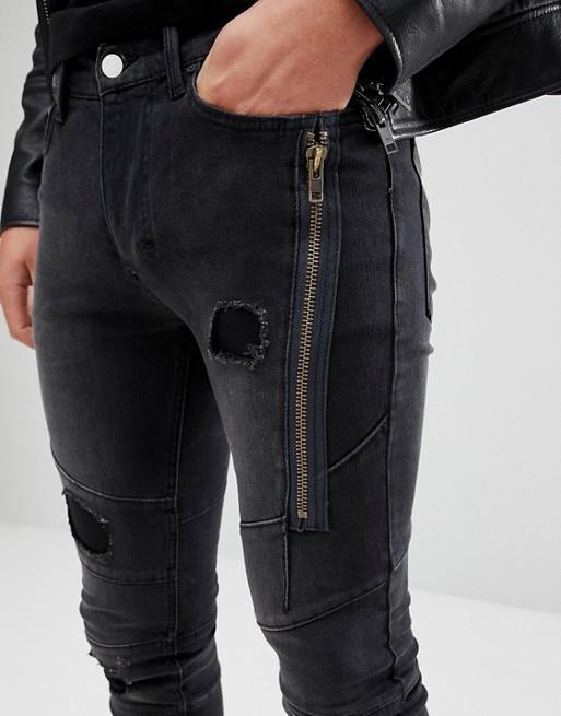 Jeans neri uomo con toppe e zip