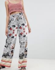 Pantaloni taglio palazzo con coulisse in vita a fiori