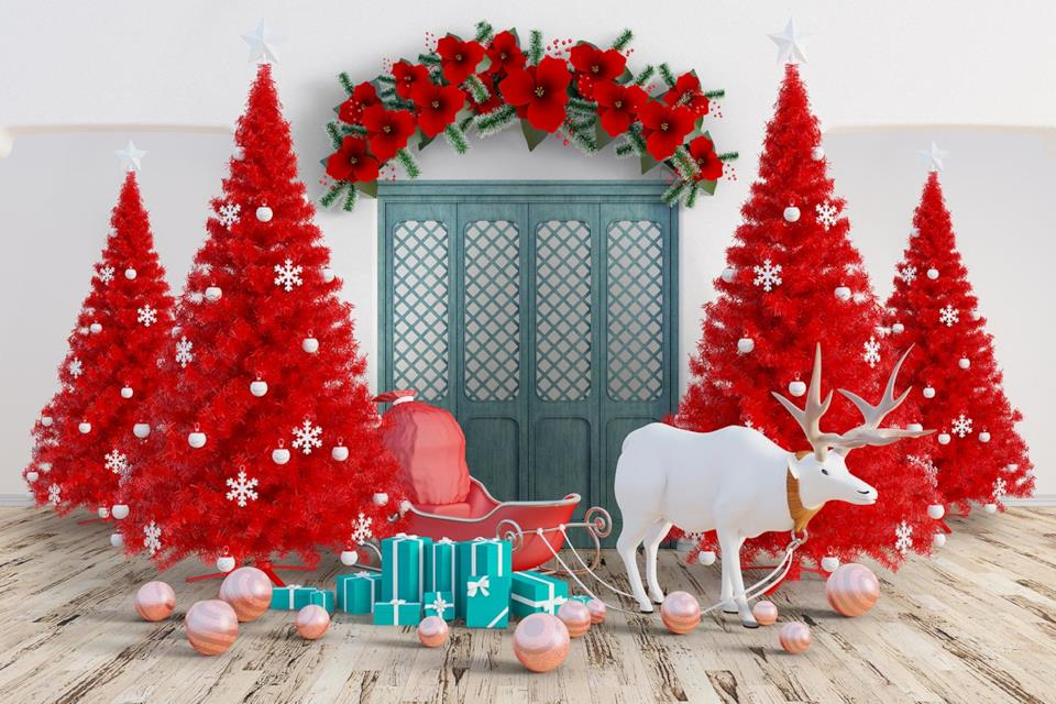 Alcuni alberi di Natale rossi con addobbi bianchi