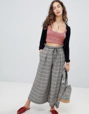Pantaloni a quadri con fondo ampio e vita alta con cintura