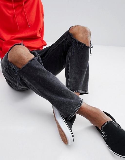 Jeans neri uomo con strappi alle ginocchia