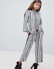 Pantaloni e camicia a righe in coordinato
