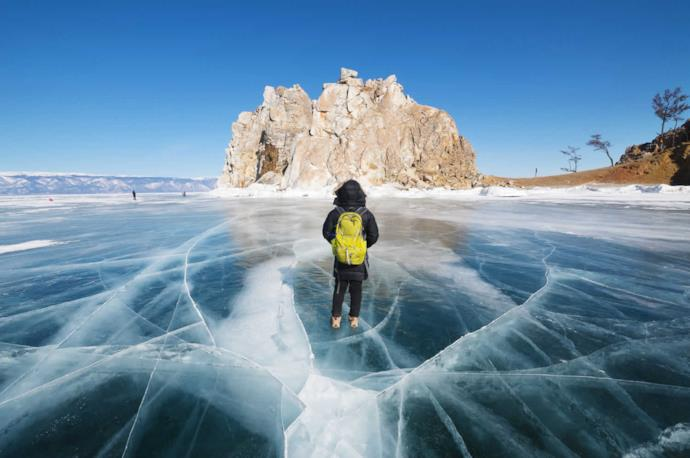 Tourist on the frozen lake of Bajkal, Russia