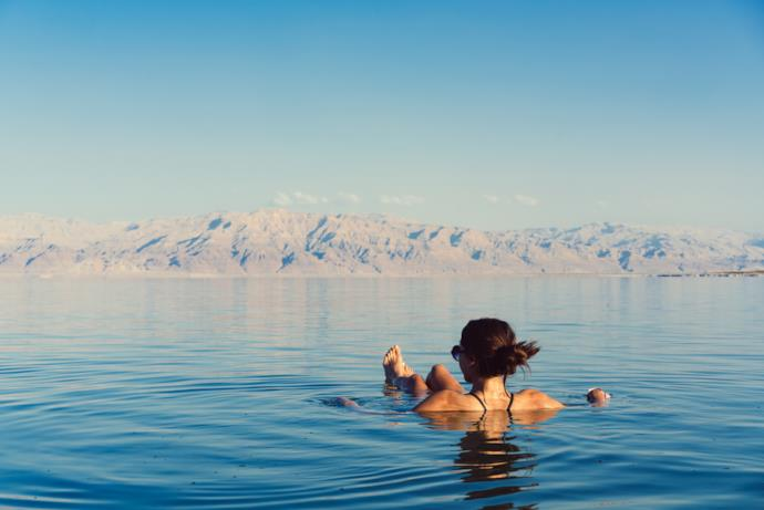 Girl bathing in the Dead Sea, Jordan