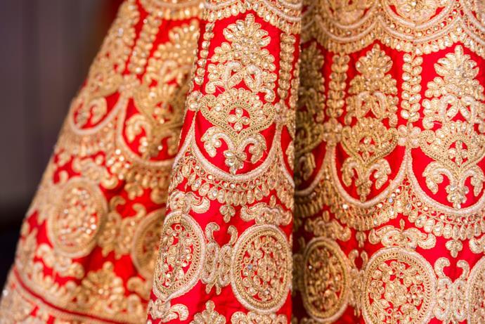 Detail of beautiful Sari in red and gold