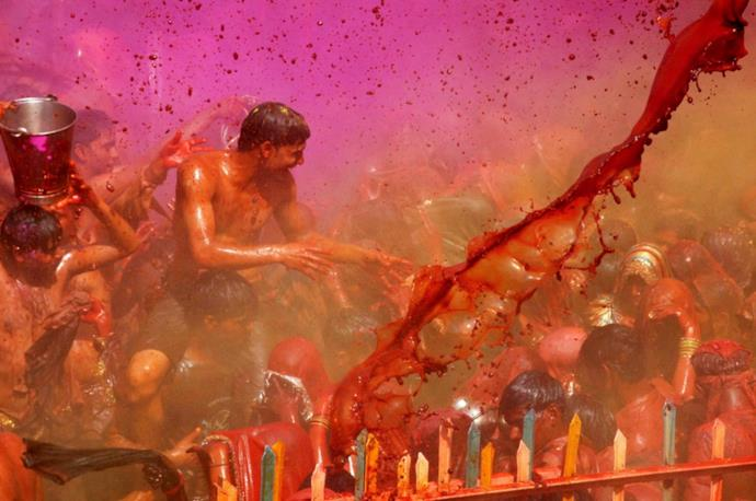Indian people throw colors on Holi Festival
