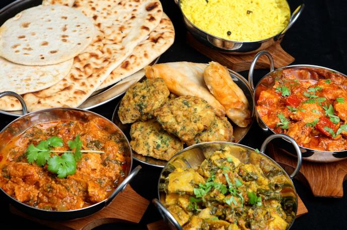Indian cuisine with naan, curry, rice