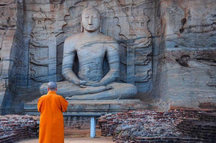Monk praying at Polonnaruwa, Sri Lanka